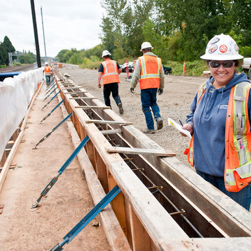 photo of a woman working on light rail construction