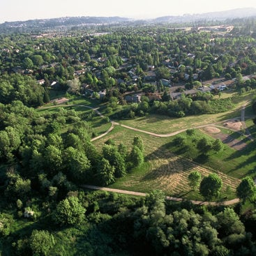 a photo of an aerial view of trees and trails through Fanno Creek Greenway