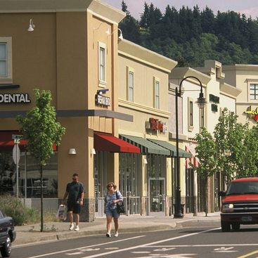 photo of pedestrians and cars in Gresham's downtown center