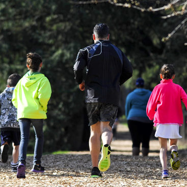 photo of a family running on the fitness trail