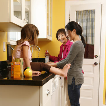 photo of a family using green cleaners in the kitchen