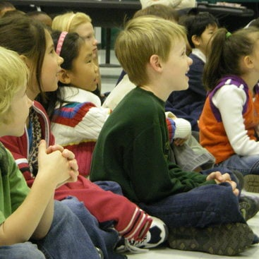 photo of kids watching a school presentation