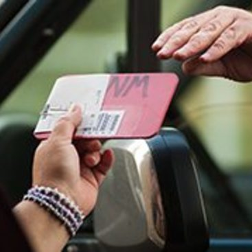 photo of a payment exchange at a transfer station