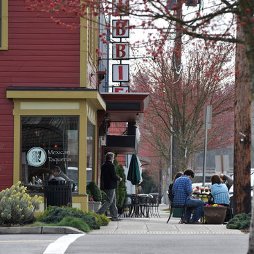 photo of downtown Milwaukie with pedestrians and restaurants