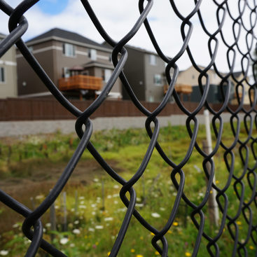 Fence with new houses behind it