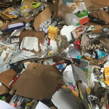 pile of commingled plastic and paper recycling