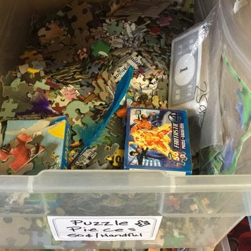 puzzle pieces and used board games to be recycled