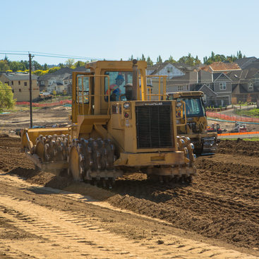 North Bethany tractor and homes under construction