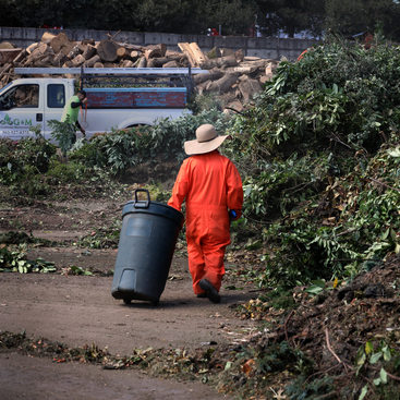 Workers tend to compost piles at Grimm's Fuel