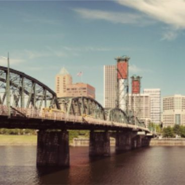 Hawthorne Bridge with downtown Portland skyline in background