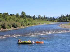 two rafts floating down Clackamas River