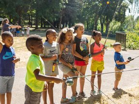 photo of Camp ELSO students learning to fish at Blue Lake