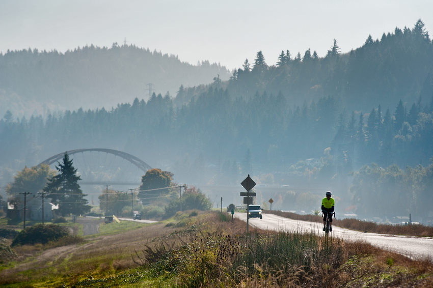 photo of the Sauvie Island Bridge and a cyclist