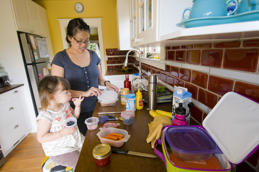 photo of mom and child making lunch