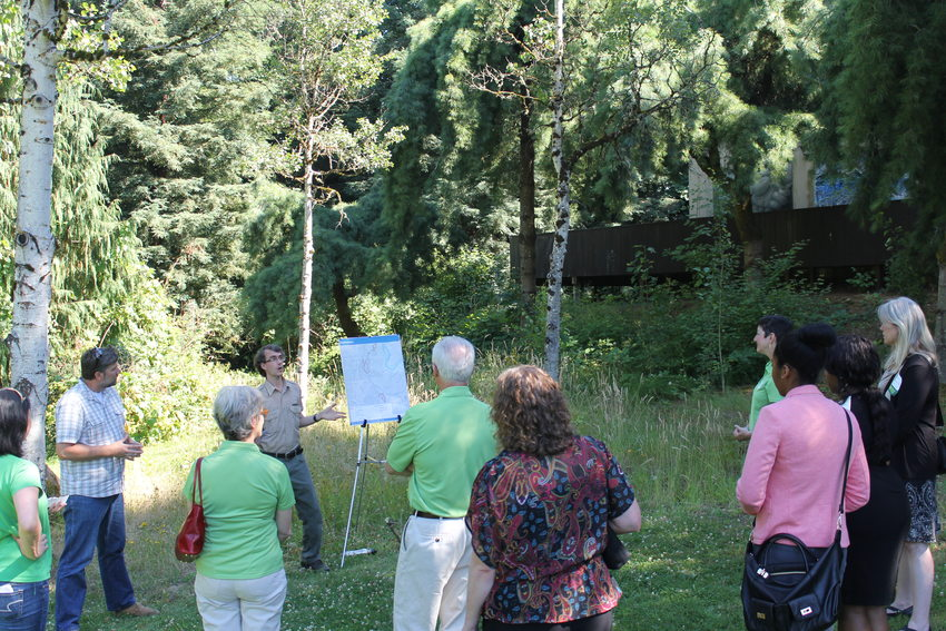 photo of Dan Daly and the Youth Ecology Corps leading a tour of Beavercreek natural are