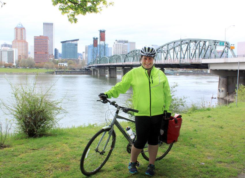 photo of a bike commuter near the Hawthorne Bridge