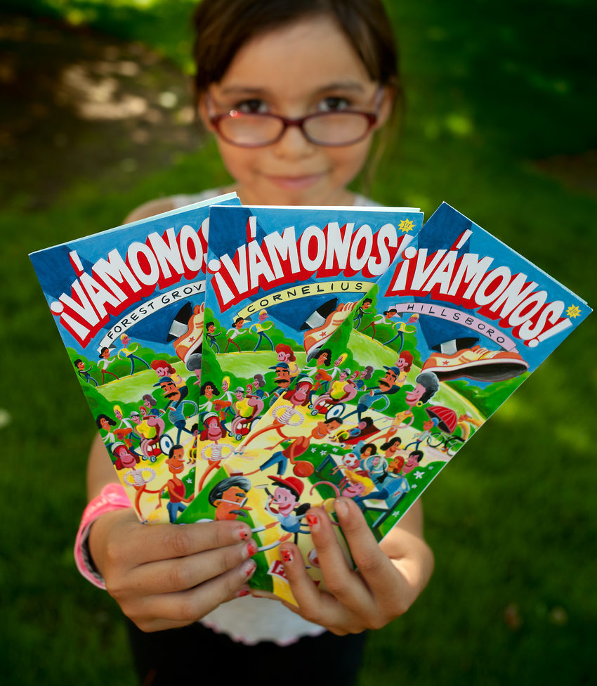 photo of a girl holding the Vamonos maps