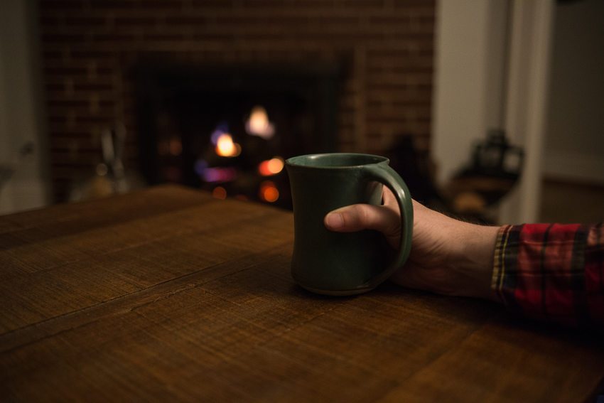 photo of a man's hand holding a coffee mug