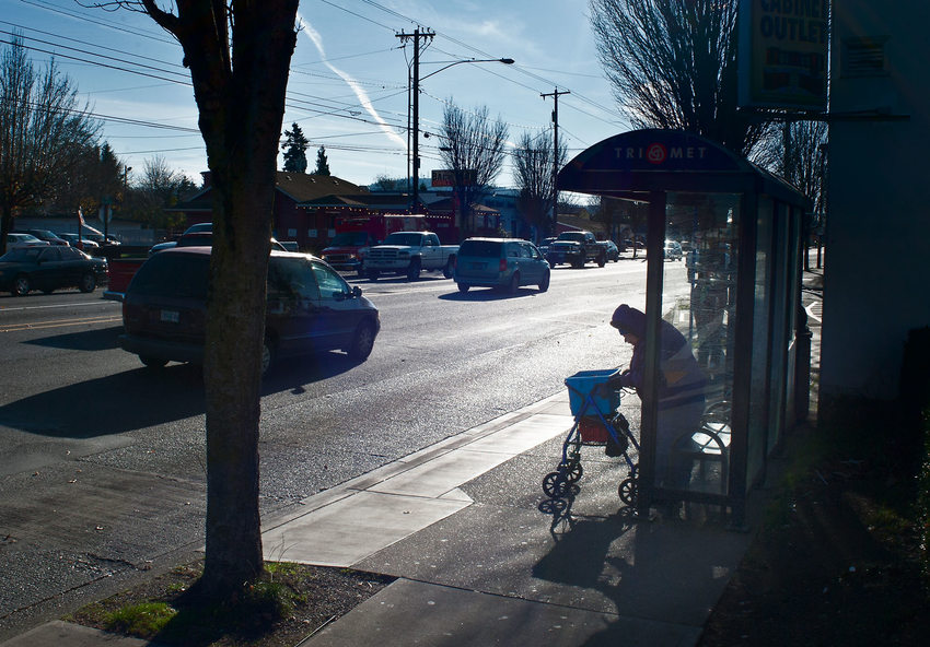 photo of woman at busstop on Powell