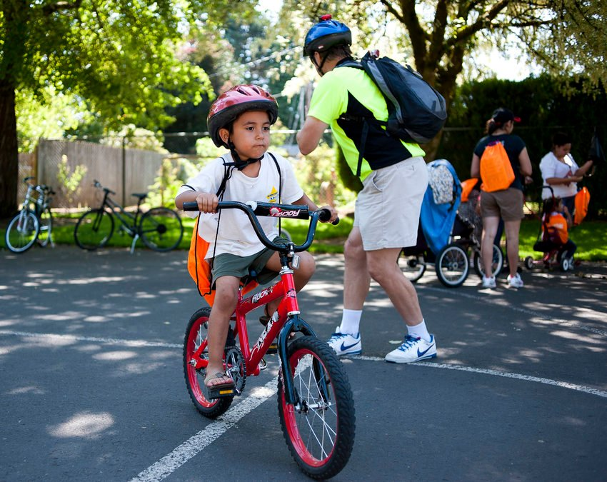 A child learns to bicycle to school