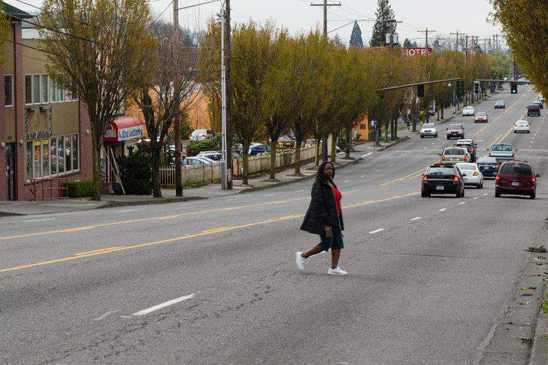 Woman crossing Southeast 82nd Avenue in Portland