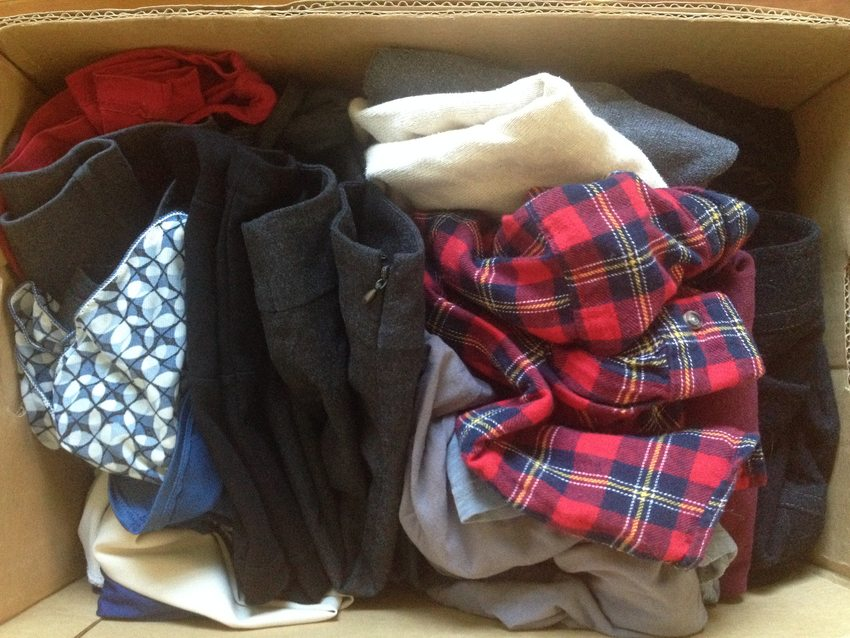 clothing to be donated in a cardboard box