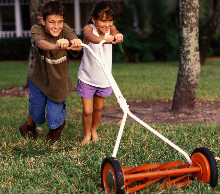 photo of kids pushing a mower