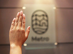 hand up at Council meeting