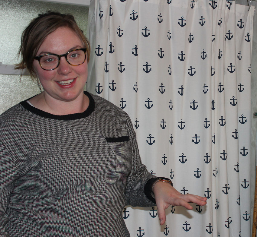 Portland homeowner Andrea Damewood standing in front of the shower curtain in her bathroom.
