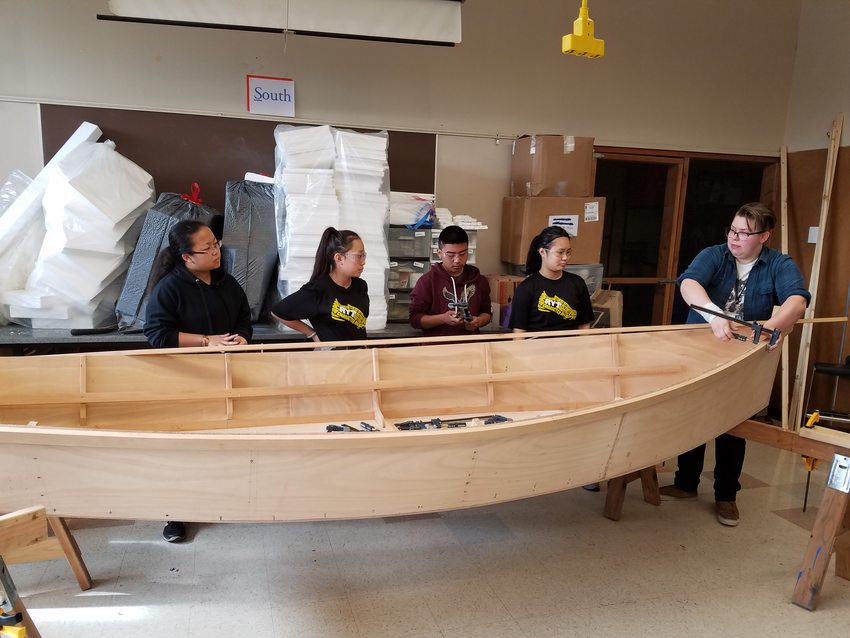 photo of George Middle School students building boat