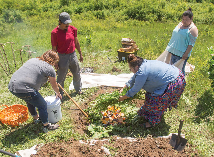 photo of preparing vegetables to roast in earth oven at Quamash Prairie