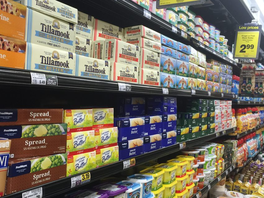A grocery store aisle with thousands of butter boxes