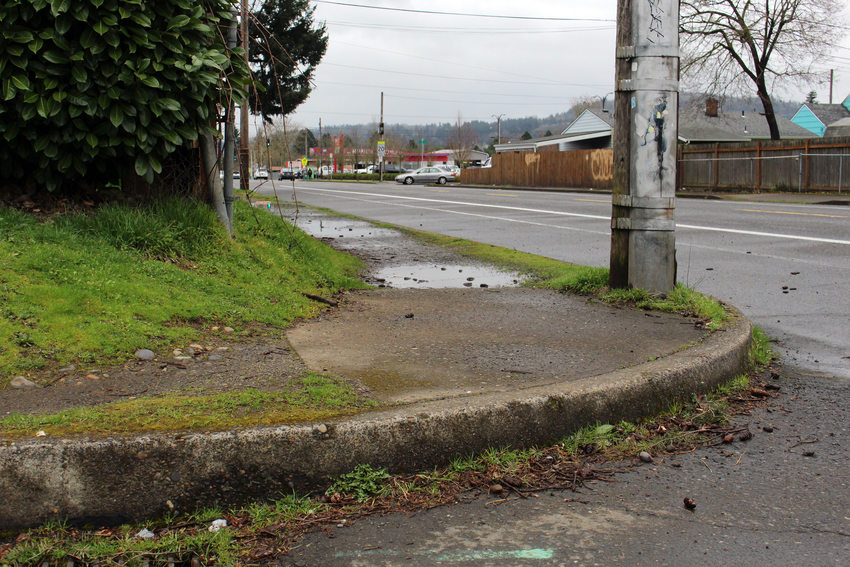 An example of a Brentwood-Darlington sidewalk without an accessible ramps,