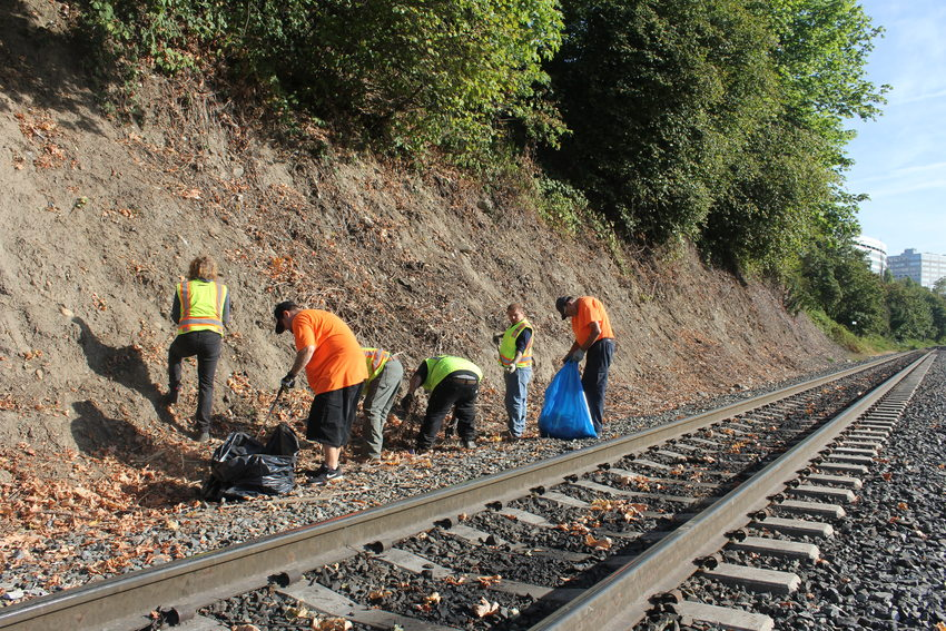 Photo of RID Patrol and cleanup crews along the railroad