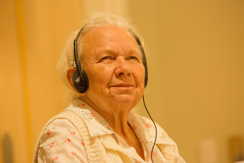 Woman with headphones listening to Russian interpreters