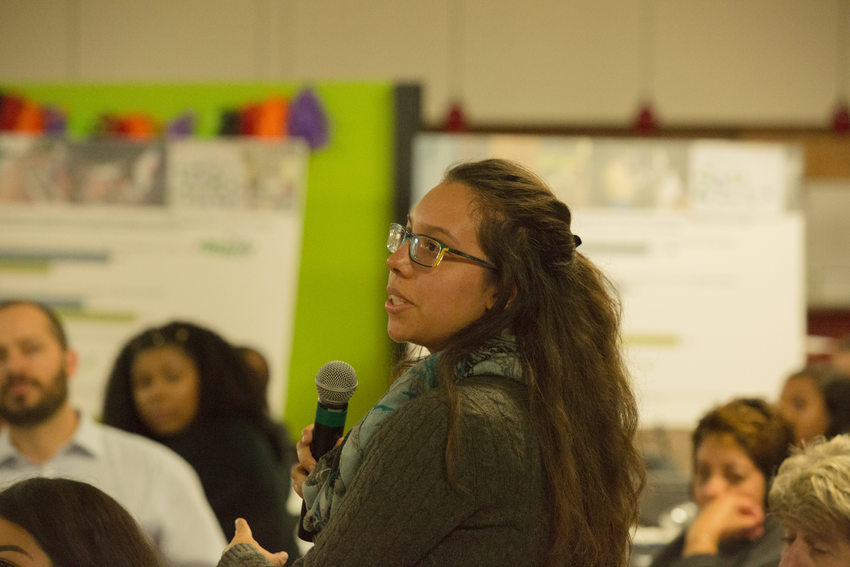 Woman asking question with microphone