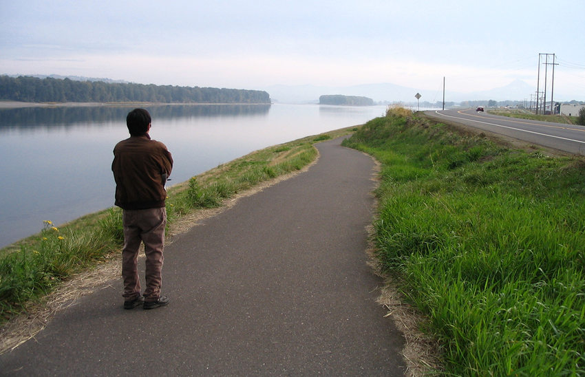 man looking at Columbia River from Marine Drive multi-use path