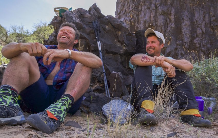 Pete McBride and Kevin Fedarko sitting in the Grand Canyon