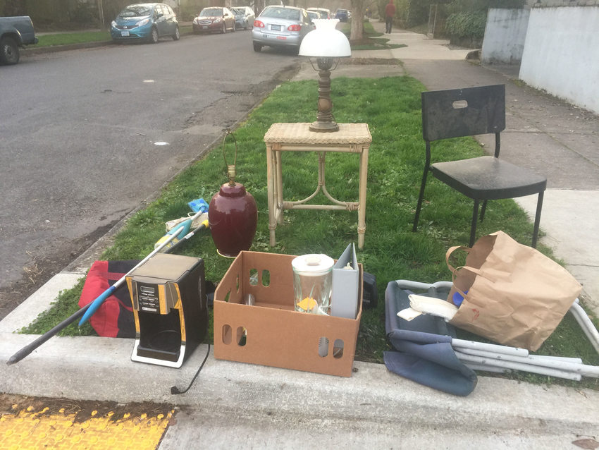 miscellaneous items set out in a parking strip as a free pile