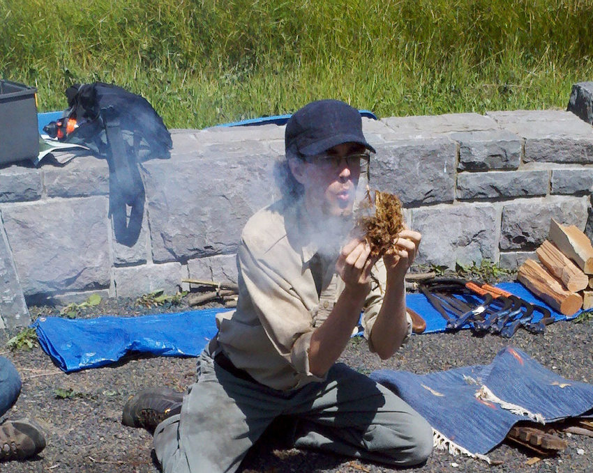 photo of a naturalist leading a fire-building class