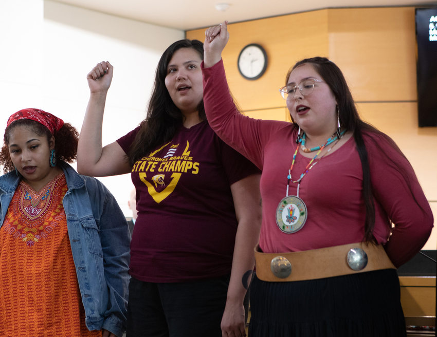Native American women sing at the Metro council