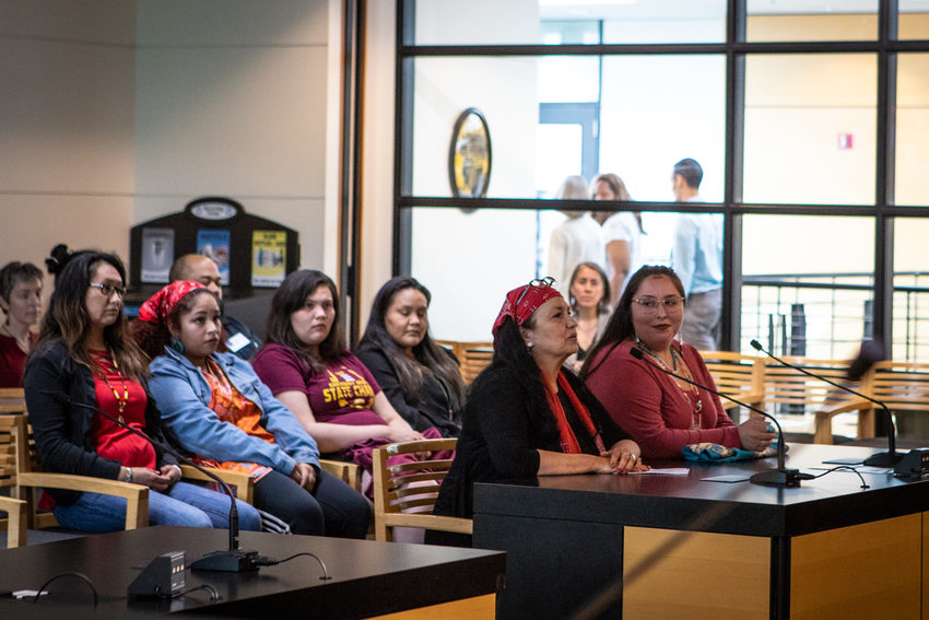 Native American women sit during a Metro council meeting