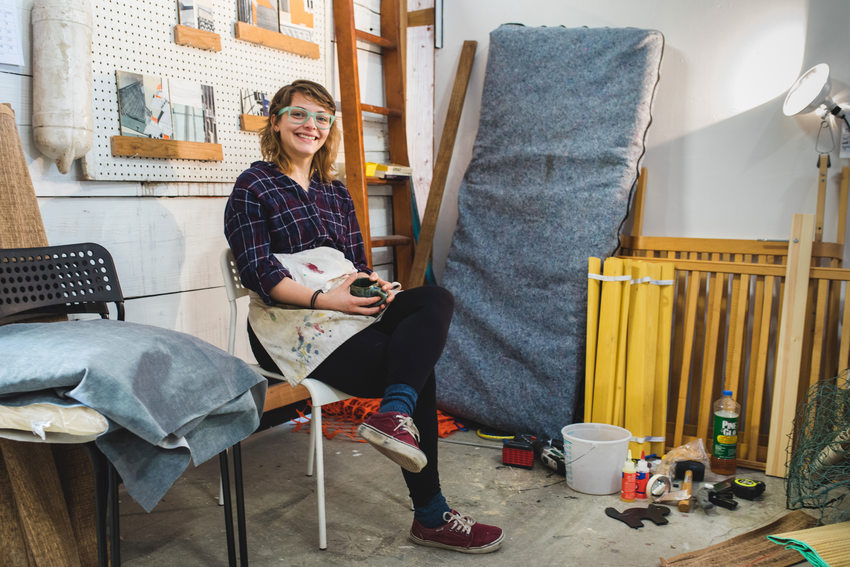 artist smiling in her work space