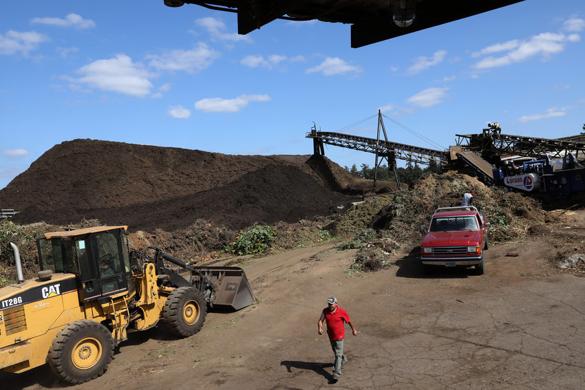 workers tend to piles of compost at grime's fuel
