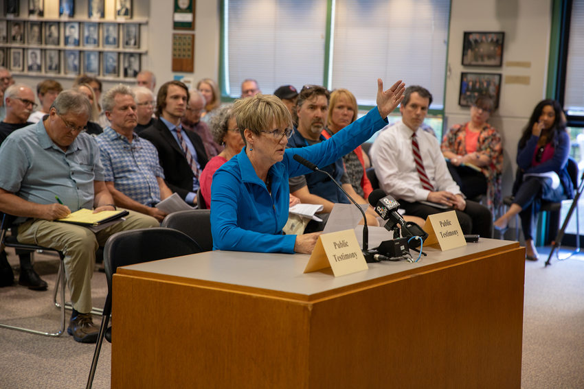 A woman gives testimony about the Southwest Corridor plan at a meeting in Tigard.