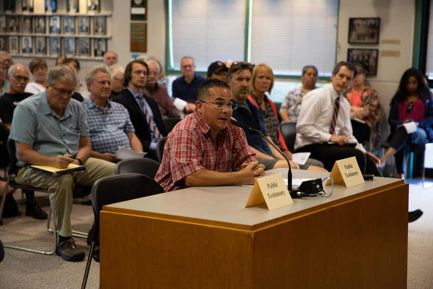 A man gives testimony about the Southwest Corridor plan at a meeting in Tigard