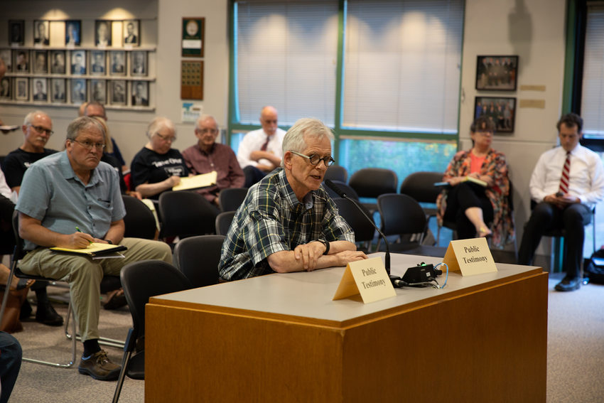 A man gives testimony about the Southwest Corridor plan at a meeting in Tigard.