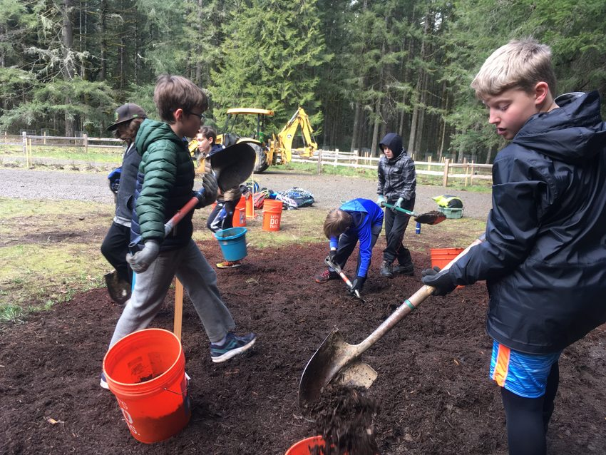 4 youths mulch planting area near new Oxbow Regional Park campground