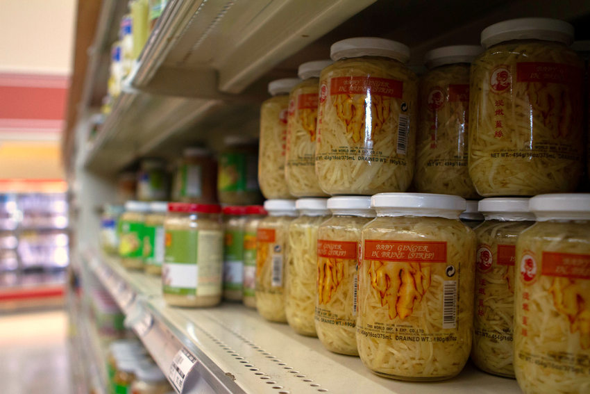glass jars of ginger sit on grocery store shelves