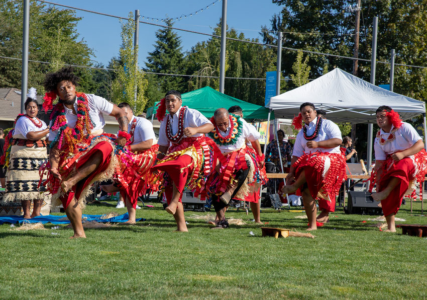 A group of performers dances on stage at Tonga Day at Gateway Discovery Park.